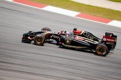 SEPANG - MARCH 28: Romain Grosjean in Practice Session 2. SEPANG - MARCH 28: Romain Grosjean of Lotus F1 Team at 2014 Formula 1 Petronas Malaysia Grand Prix Royalty Free Stock Image