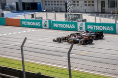 SEPANG - MARCH 29: Romain Grosjean Vs Nico Hulkenberg Stock Photos
