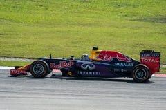 SEPANG - MARS 27: Daniel Ricciardo i den första kurvan Arkivfoton