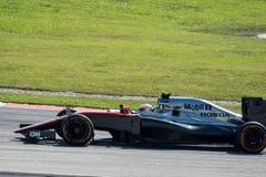 SEPANG - MARS 27: Jenson Button i den första kurvan Royaltyfri Bild
