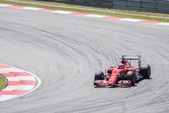 SEPANG - MARS 27: Kimi Räikkönen i den första kurvan Royaltyfri Fotografi