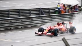 SEPANG - MARS 29: Kimi Räikkönen körningsregn Royaltyfria Bilder
