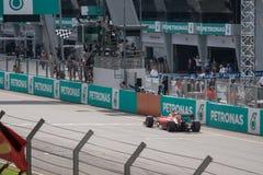 SEPANG - MARS 29: Sebastian Vettel har Finishline Royaltyfri Fotografi