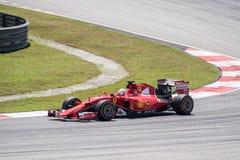 SEPANG - MARS 27: Sebastian Vettel i den första kurvan Royaltyfria Foton