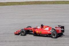 SEPANG - MARS 27: Sebastian Vettel i den sista kurvan Royaltyfri Foto