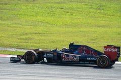 SEPANG - 27 MARZO: Carlos Sainz in prima curva Immagine Stock