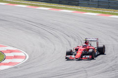 SEPANG - 27 MARZO: Kimi Räikkönen in prima curva Fotografia Stock Libera da Diritti