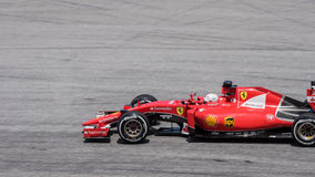 SEPANG - 27 MARZO: Sebastian Vettel in ultima curva Fotografia Stock Libera da Diritti