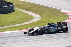 SEPANG - 27 MARZO: Sergio Perez in prima curva Immagine Stock