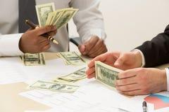 Separación de dinero fotografía de archivo