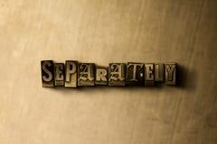 SEPARAT - närbild av det typsatta ordet för grungy tappning på metallbakgrunden Arkivbild