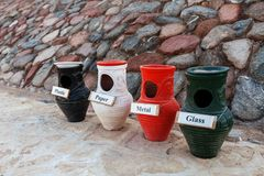 Separate collection of garbage and clay pots. royalty free stock photo