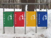 Separate colored garbage containers. Winter Stock Photo