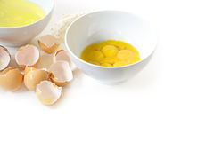 Separate the eggs for baking, egg yolk and egg white in bowls Stock Photos