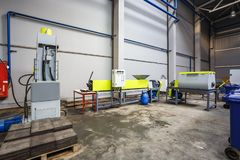 Separate garbage collection. Equipment for pressing debris sorting material to be processed in a modern waste recycling plant stock photo