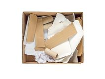 Paper waste in the carboard box isolated on white. Separate garbage collection. Paper waste in the carboard box isolated on white top view Royalty Free Stock Photography