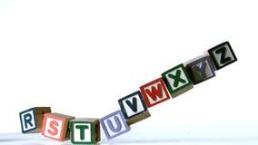 Separated alphabet blocks falling over Stock Photo