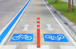 Separated blue line bicycle lane for cyclist on the urban traffic road, Thailand royalty free stock photo