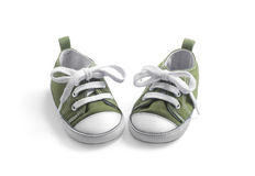 Separated kid sneakers on white Royalty Free Stock Images