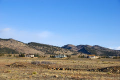 Separated Mansions on Arid Land Stock Photo