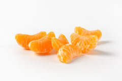 Separated segments of tangerine Stock Images
