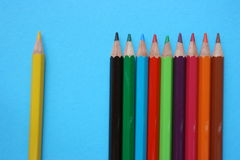 A separated yellow color pencil. A distanced color pencil from the rest Stock Photo