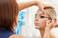 Separating and curling lashes with mascara brush Stock Image