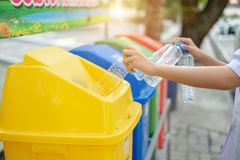 Separating waste plastic bottles into recycling bins is to protect the environment, causing no pollution, reduce global warming,