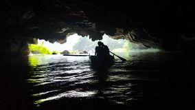 SEPARATION. Cave , separation, boat , Vietnam , person Stock Images