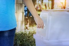 Separation of garbage and dumping of waste into the garbage keep. S the city clean Stock Image