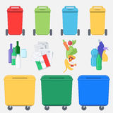 Separation of waste on garbage bins. Recycling bins with plastic. Paper, glass and  organic waste. Waste management concept Stock Photo