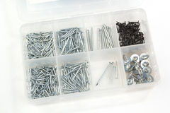 Seperated box with different metallic nails on white Royalty Free Stock Images
