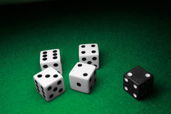 Seperated Dice over Green. Dice seperated over a table of green felt Royalty Free Stock Photography