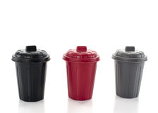 Seperated waste. Containers in red black and gray for seperated waste stock photos