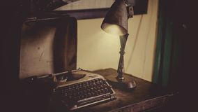 Sephia Photography of Desk Lamp Lightened the Gray Typewriter on Wooden Table Stock Image