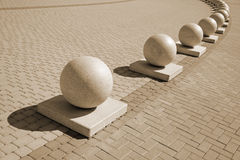 Sepia. Protection in the form of decorative stone spheres on sidewalk (sepia Royalty Free Stock Photos