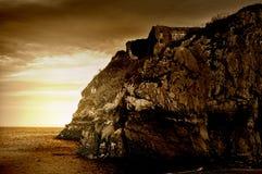 Sepia abgetönter Cliff Ruins Stockfotografie