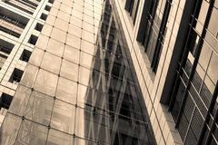 Sepia abstract building walls made of steel and glass. High urban impressive modern construction concept. Monochrome business center wall view. Finance center Royalty Free Stock Photo
