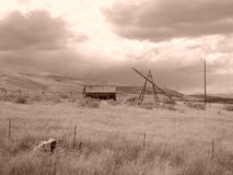 Sepia Barn Days gone by. An old homestead in Clear Creek, Utah Stock Image