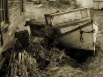 Sepia Boat. An old wooden fissing vessel neglected over time Stock Image