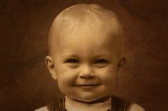 Sepia bonito de sorriso do miúdo Fotografia de Stock Royalty Free