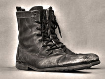 Sepia boots on a grunge background. Sepia toned boots and a grunge background Royalty Free Stock Photos