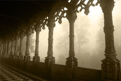 Portugal - Bussaco Palace Arched Gallery, Tracery Design, Foggy Day - Sepia Image royalty free stock image