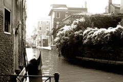 Sepia Canal. Gondola parked outside of someone's home in Venice, Italy. Photo has been sepia-toned and processed to look like infrared film Royalty Free Stock Photography