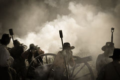 Sepia Cannon crew in battlefield Royalty Free Stock Photo
