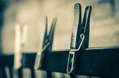 Sepia clothes pegs Royalty Free Stock Images
