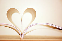 Sepia color heart shape of book pages. Royalty Free Stock Photos