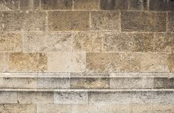 Sepia colored stone blocks on weathered church wall. Rough surface of aged church wall royalty free stock images