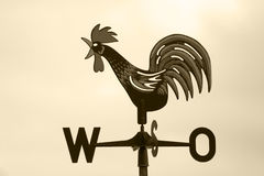 Sepia coloured rooster. Rooster weather vane in sepia stock photography