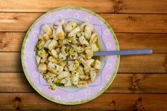 Sepia de las jibias con aletas con felices ajo y perejil de la salsa Fotografía de archivo